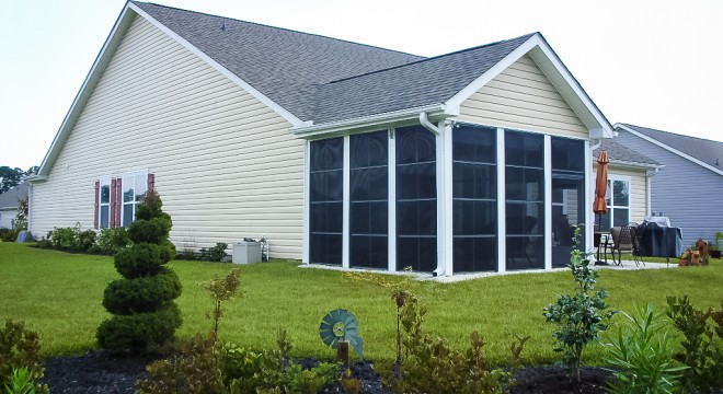 eze-breeze-vertical-four-track-windows-exterior-view-beige-siding